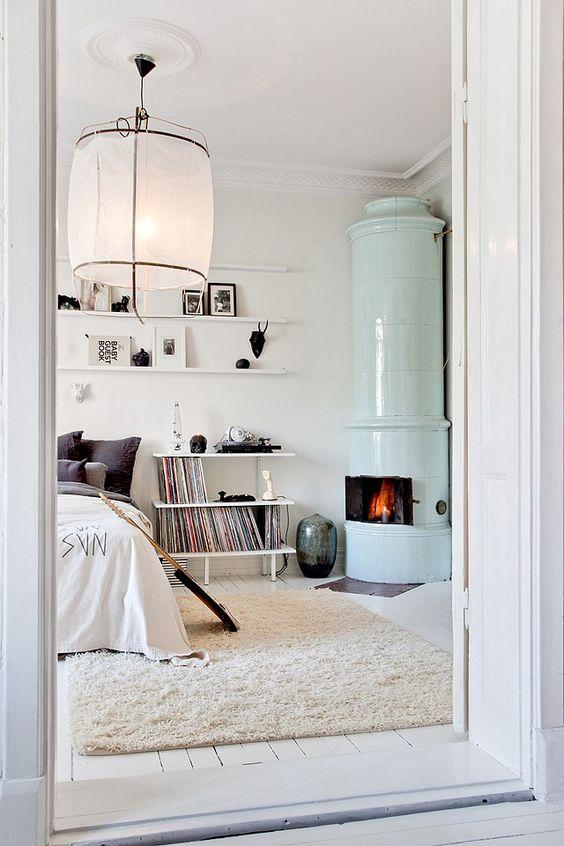 scandinavian bedroom with fireplace