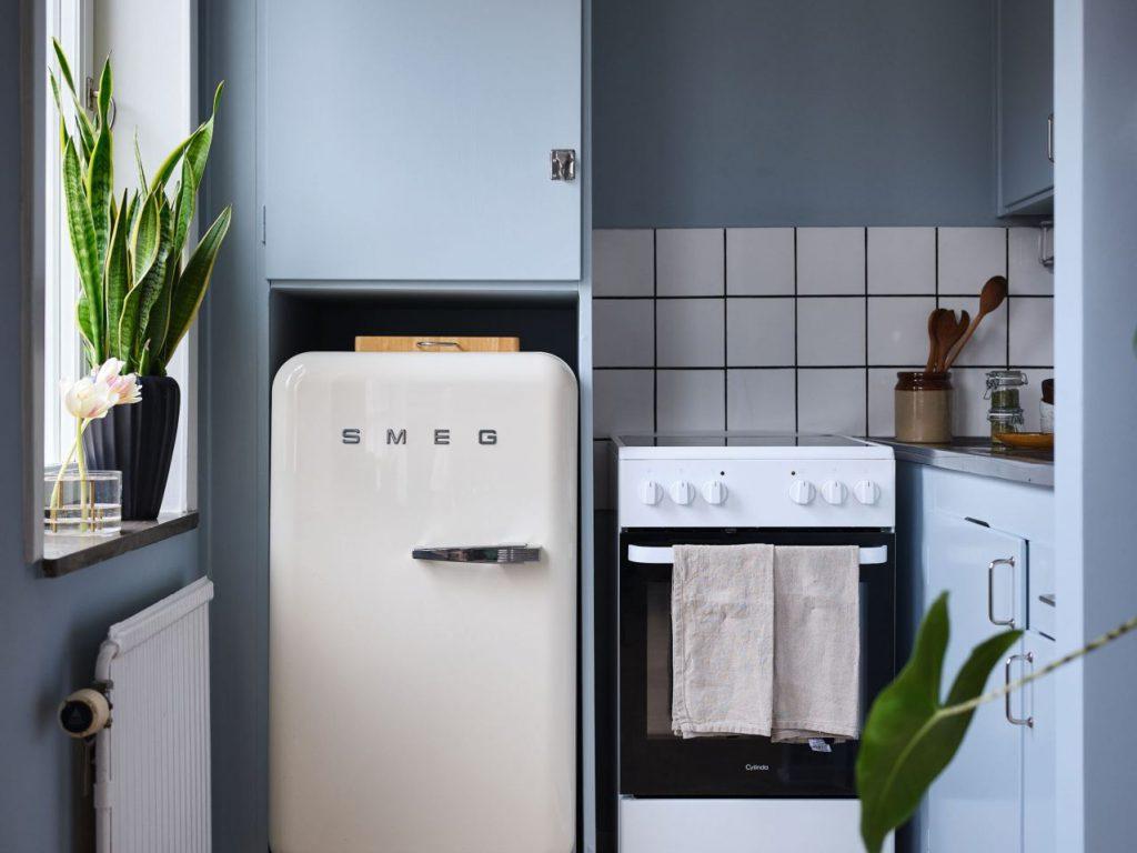 minimalist kitchen in studio apartment