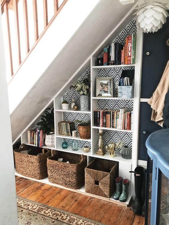 utilizing space under the stairs ideas